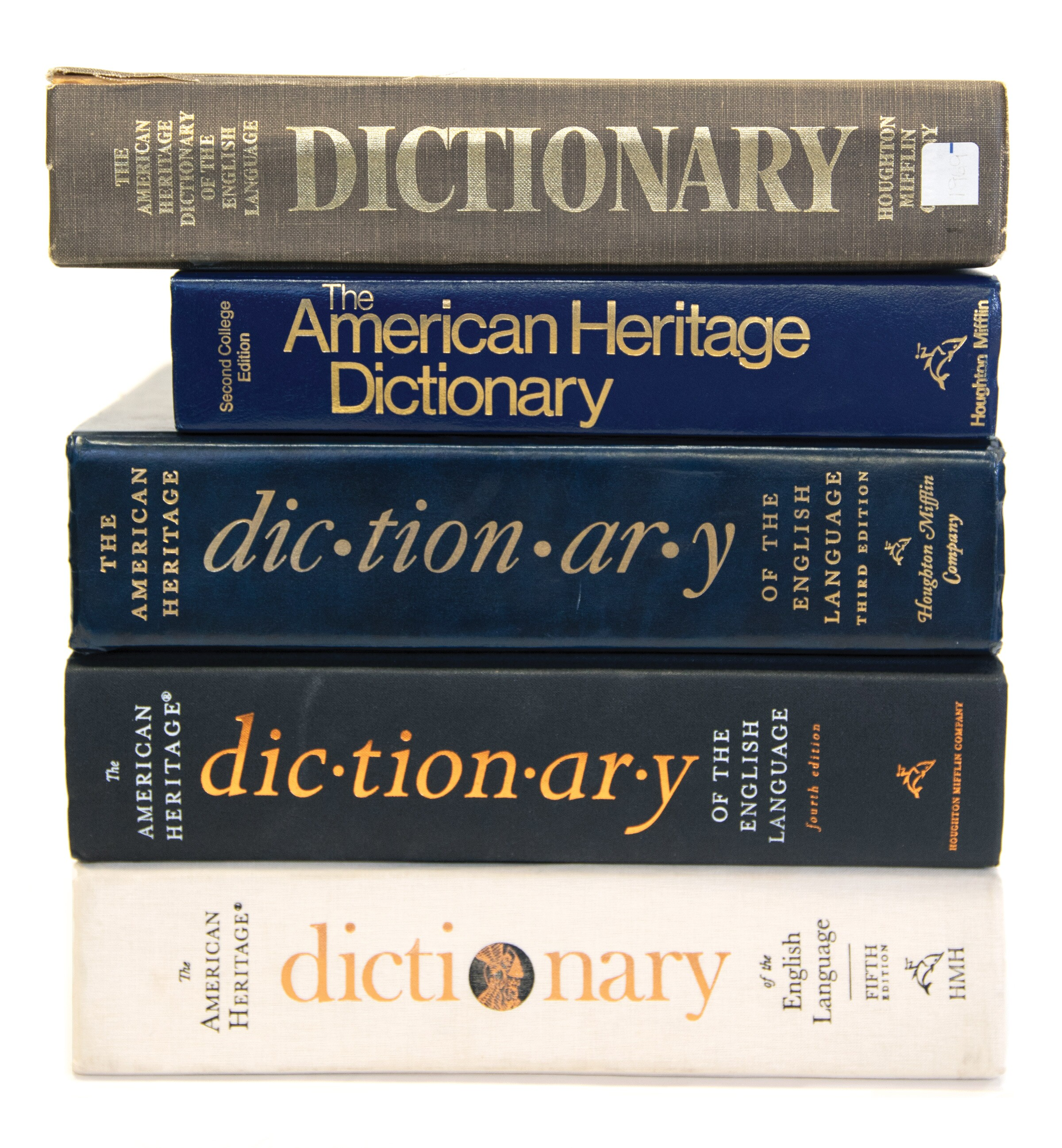 Skinner - American Heritage Dictionary - pile of all editions