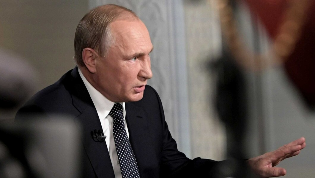 """Russian President Vladimir Putin gestures during an interview with """"Fox News Sunday"""" host Chris Wallace."""