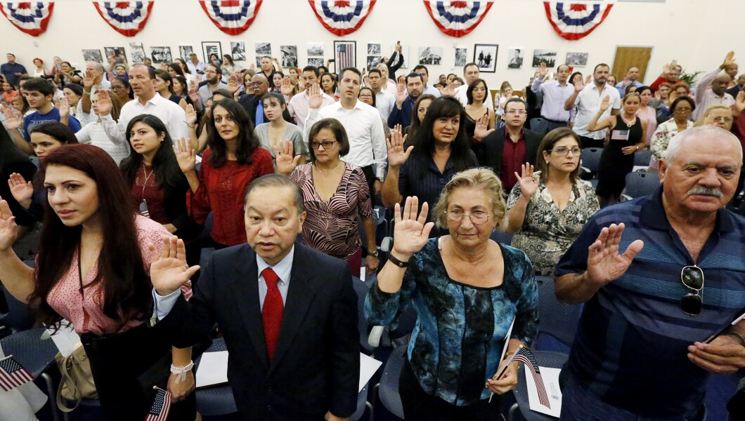 New American citizens recite the Oath of Allegiance during a naturalization ceremony at the U.S. Citizenship and Immigration Services Miami Field Office on Aug. 17, 2018 in Miami.