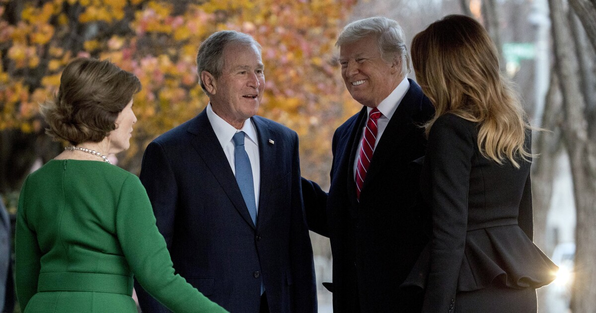 Bush family welcomes Trump, in marked departure from McCain funeral