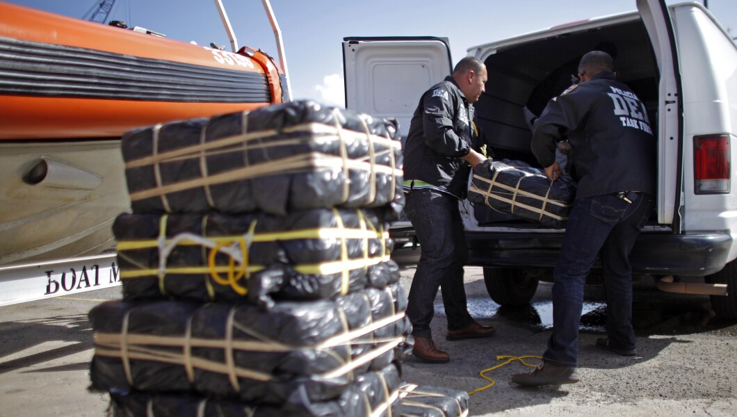 DEA agents load bales of cocaine into a van after a news conference at the U.S. Coast Guard base in San Juan, Puerto Rico.