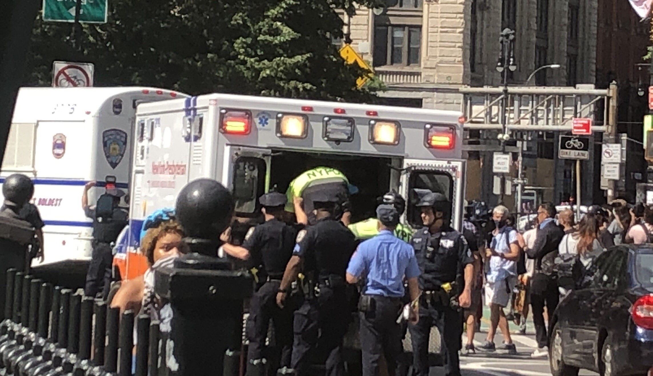 An injured New York Police Department officer is loaded into an emergency vehicle.