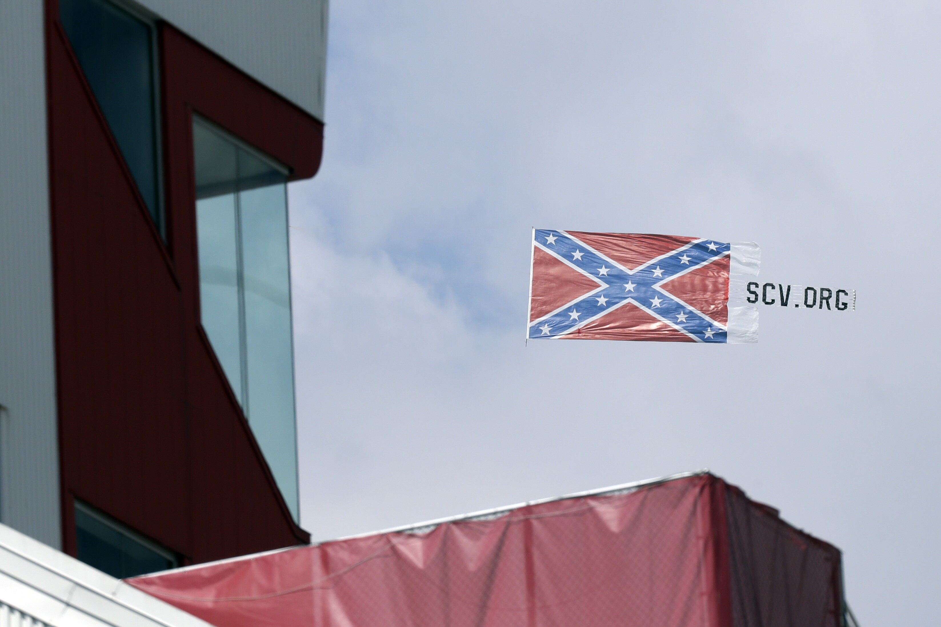 A plane pulls a Confederate battle flag over Bristol Motor Speedway before the NASCAR All-Star auto race in Bristol, Tennessee, on Wednesday.