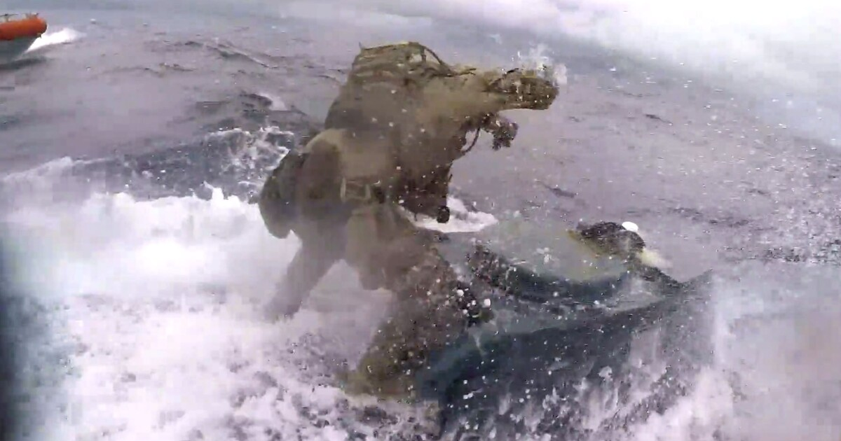 watch  coast guardsman jumps onto moving narco submarine