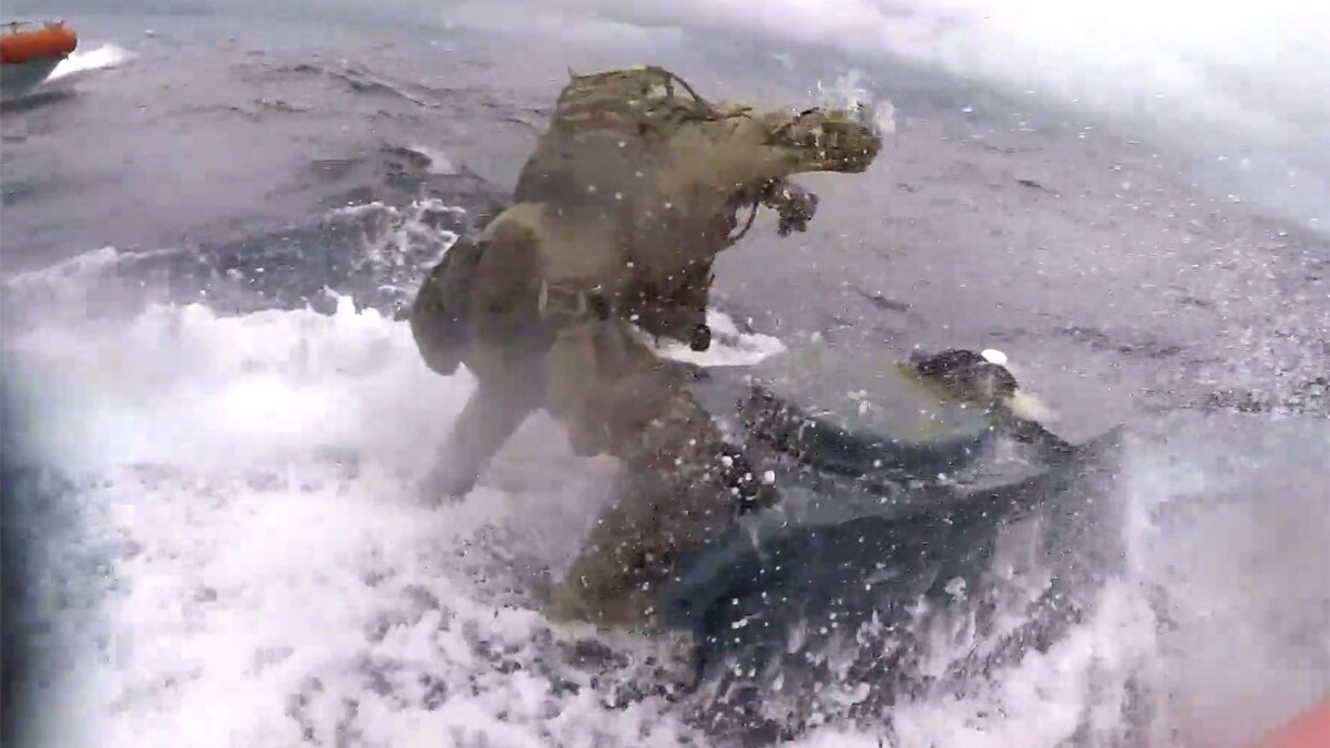 Coast Guardsman jumps onto moving narco submarine and punches it