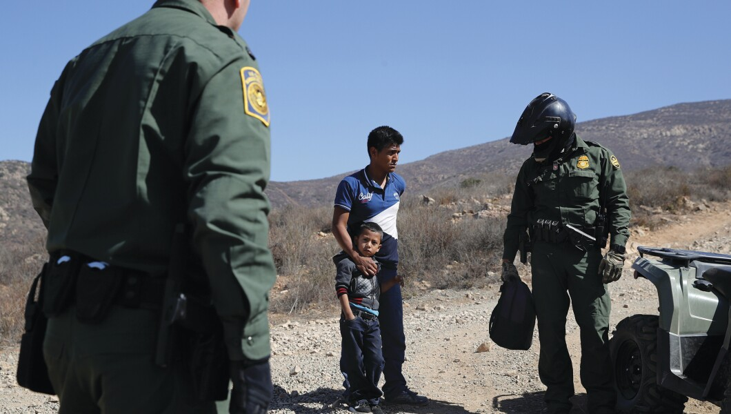 Smugglers flood border with migrants to divert security