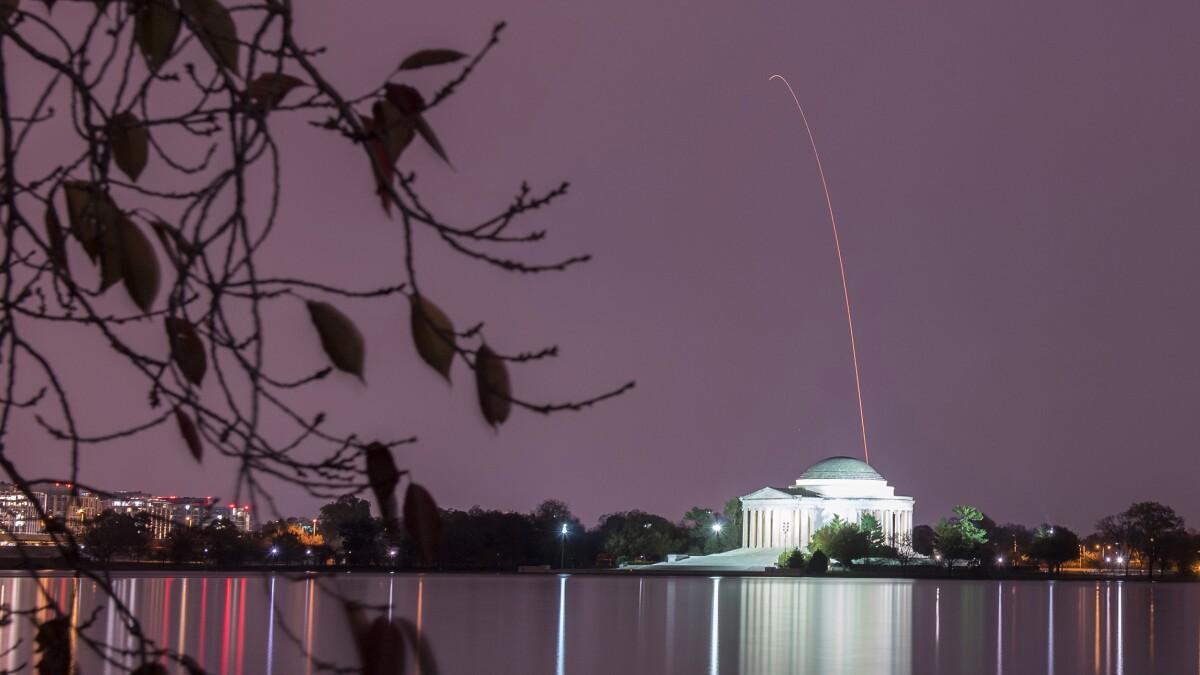 NASA releases stunning photo of Antares rocket climbing behind Thomas Jefferson Memorial