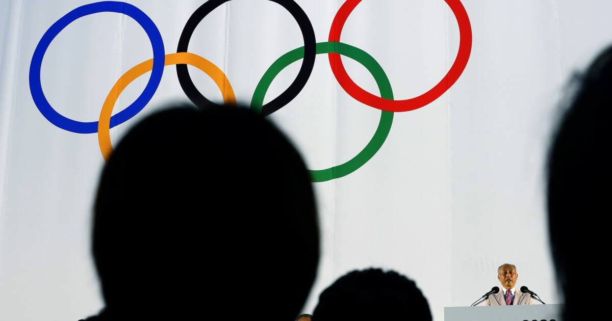 Japan under pressure to scrap Olympics amid slow vaccination pace
