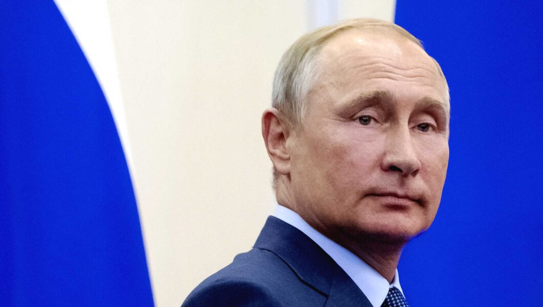 Russian President Vladimir Putin leaves the hall after a news conference.