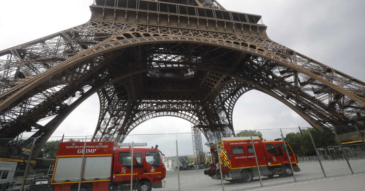 Eiffel Tower closed and evacuated after person scales the monument