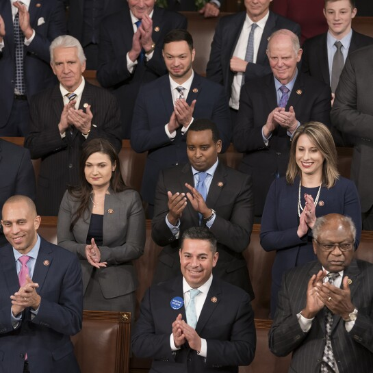 Members of the new House Democratic leadership, front row from left, Rep. Katherine Clark, D-Mass., the vice chair of the Democratic Caucus, Democratic Caucus Chair Hakeem Jeffries, D-N.Y., Assistant Democratic Leader Ben Ray Lujan, D-N.M., House Majority Whip James Clyburn, D-S.C., and House Majority Leader Steny Hoyer, D-Md., join others in their caucus in applauding Speaker of the House Nancy Pelosi, D-Calif., on the opening day of the 116th Congress.