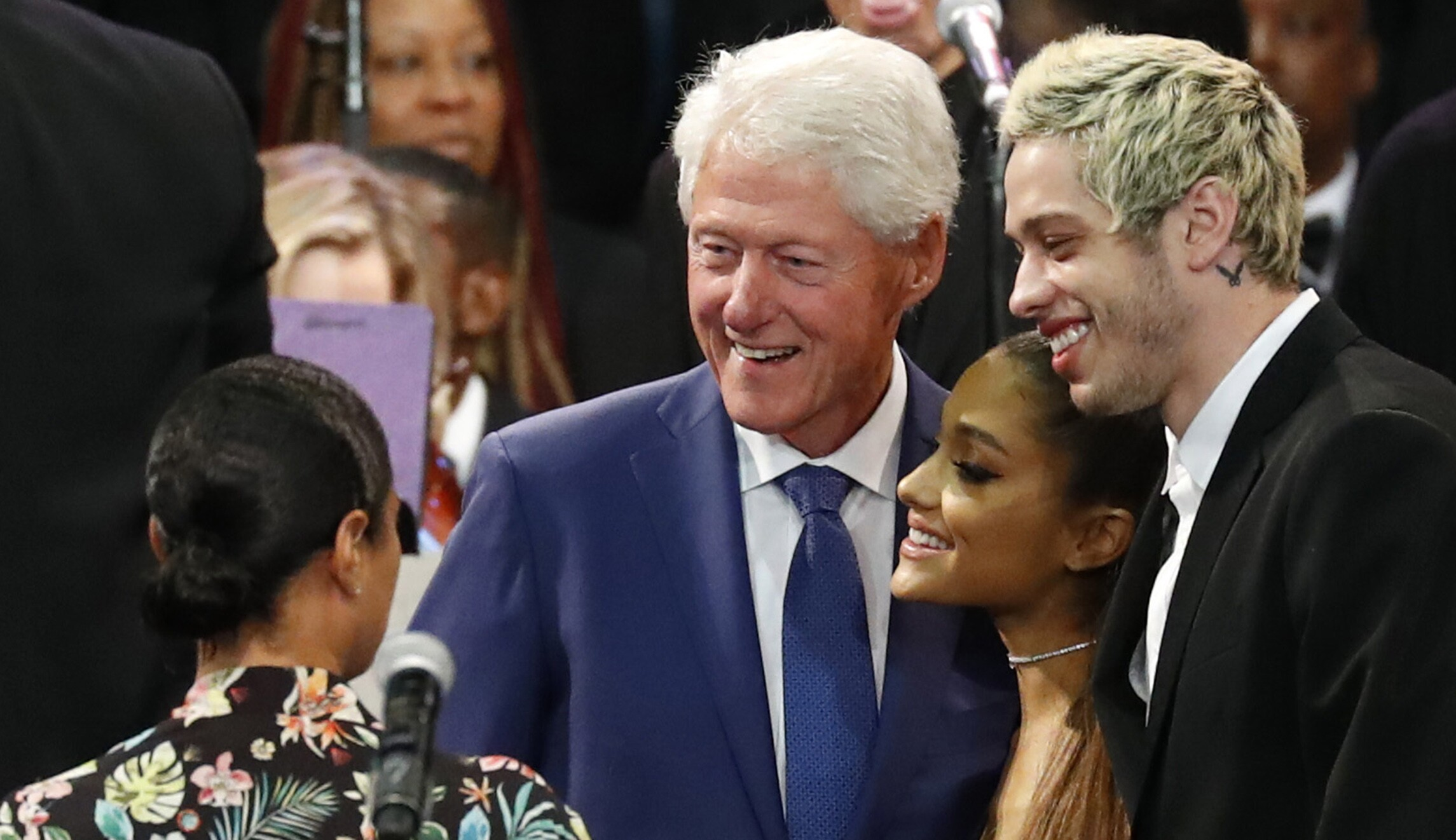 Former President Bill Clinton poses for a photo with Ariana Grande (center) and Pete Davidson (right) during the funeral service
