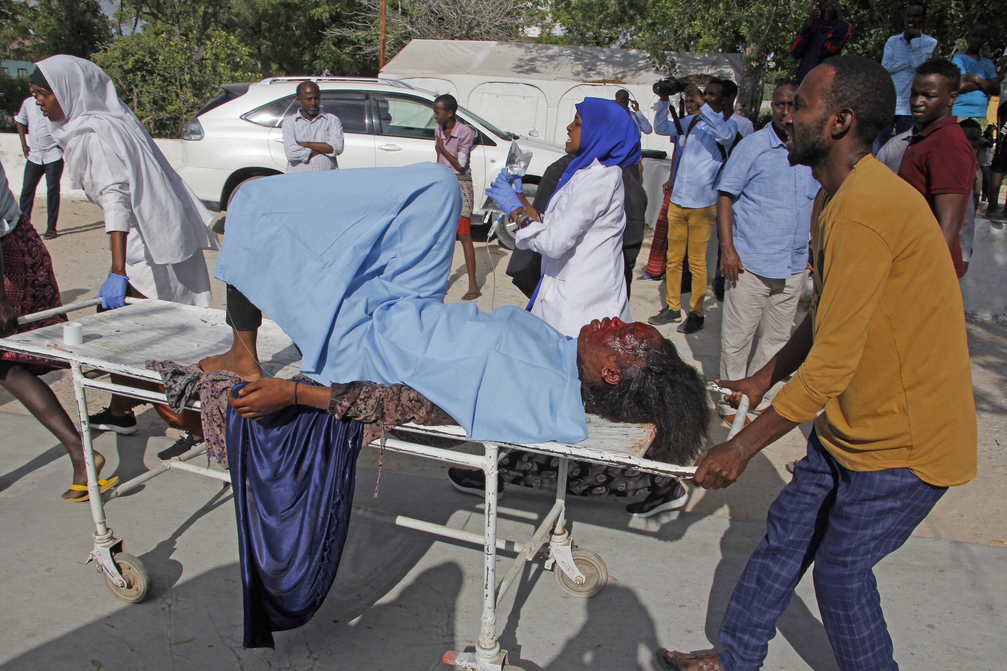 A victim of the attack is carried on a stretcher
