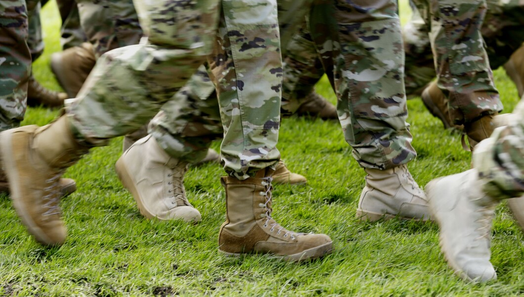 U.S. Army soldiers wear boots as they march in formation.