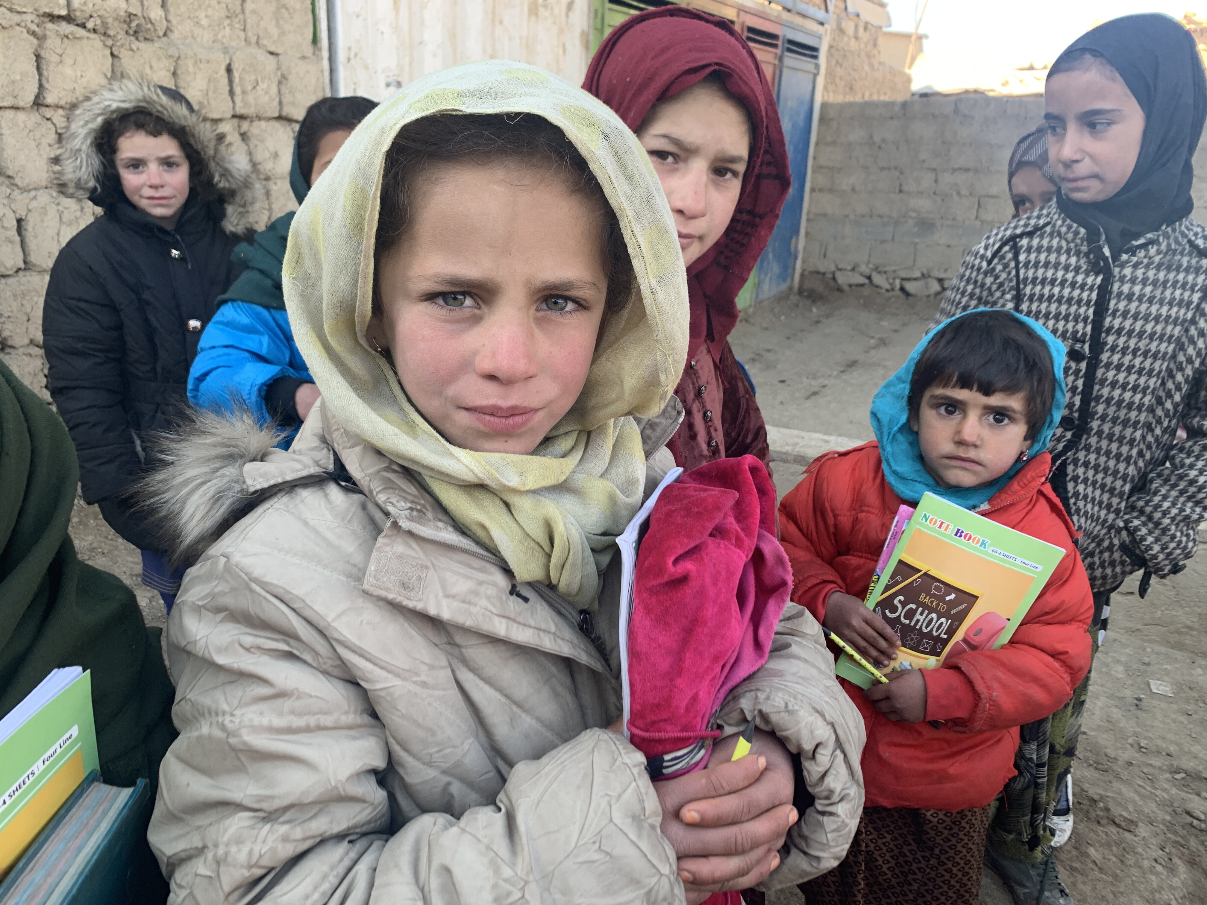 Afghan students waiting to attend school