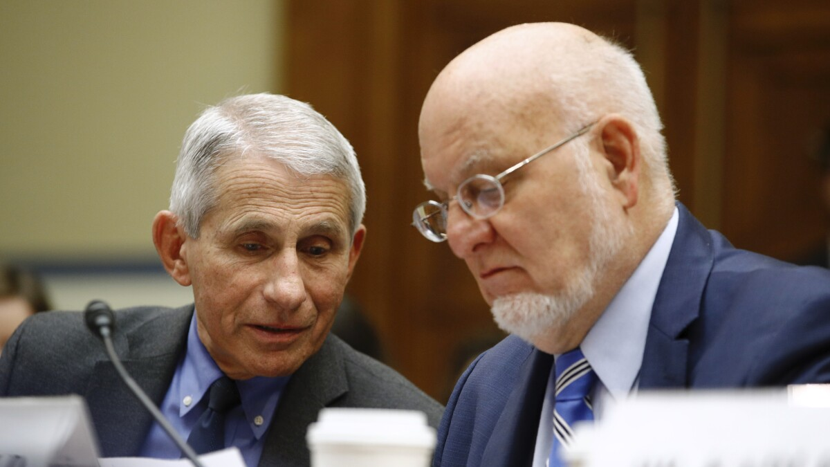 Anthony Fauci, Robert Redfield