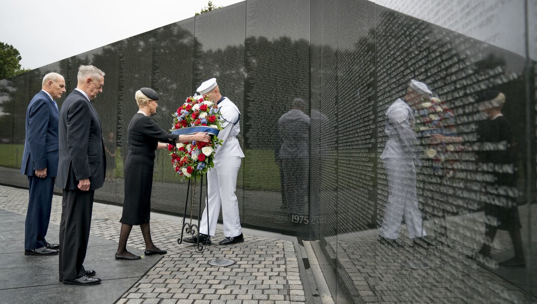 Cindy McCain, wife of, Sen. John McCain, R-Ariz., accompanied by President Trump's Chief of Staff John Kelly, left, and Defense Secretary Jim Mattis, second from left, lays a wreath at the Vietnam Veterans Memorial in Washington, Saturday, Sept. 1, 2018.