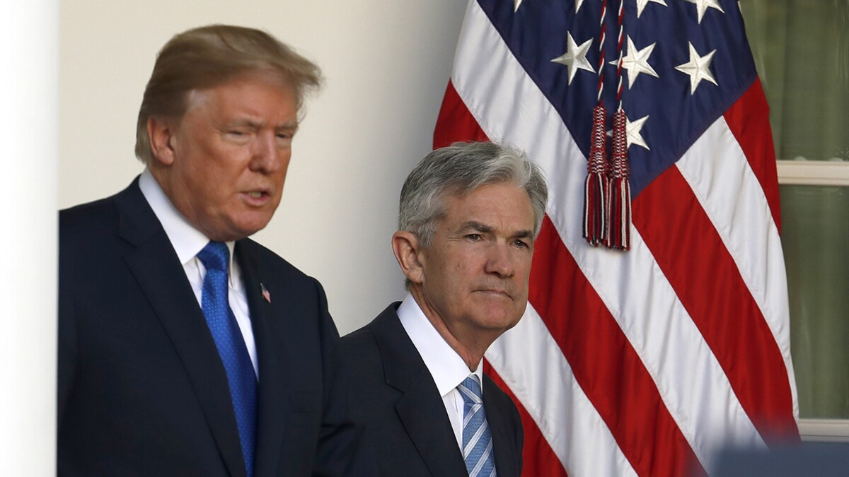 Fed cuts rates, facing global risks and amid pressure from Trump