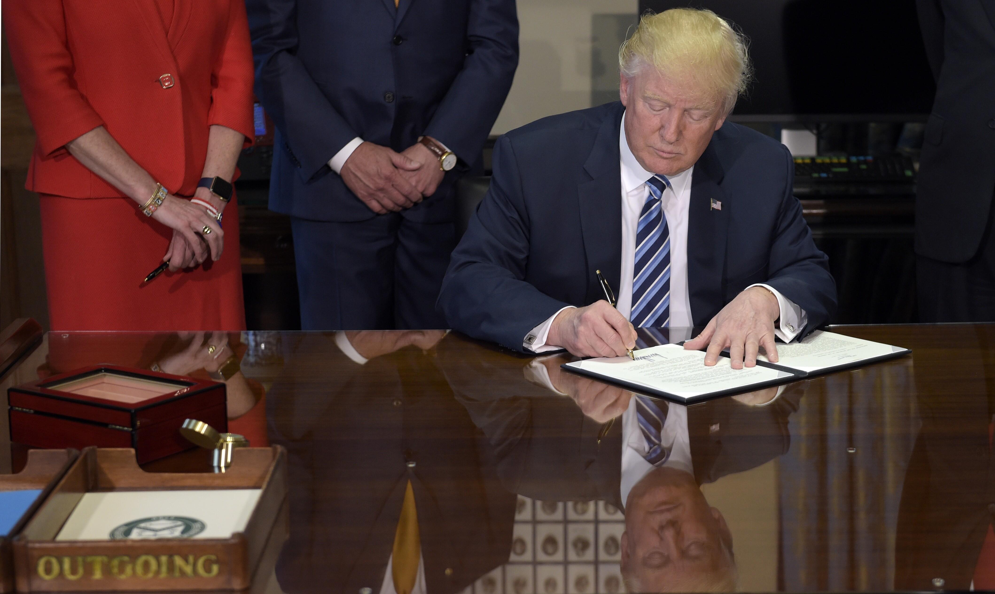 Image result for Trump slashing regulations