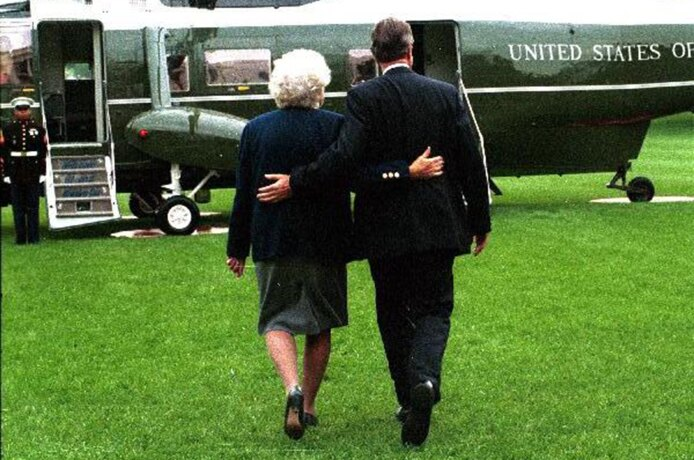 President George H.W. Bush and Barbara Bush Walk Arm in Arm to Marine One
