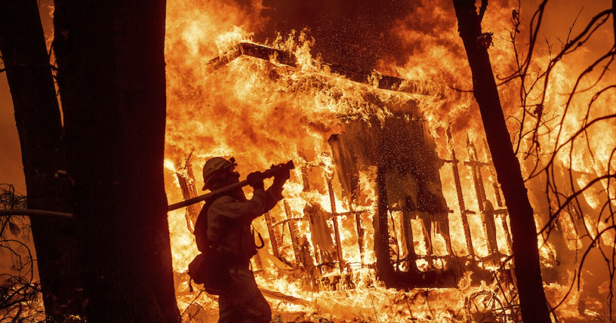 PG&E tumbles amid liability risk in California's rampaging Camp Fire