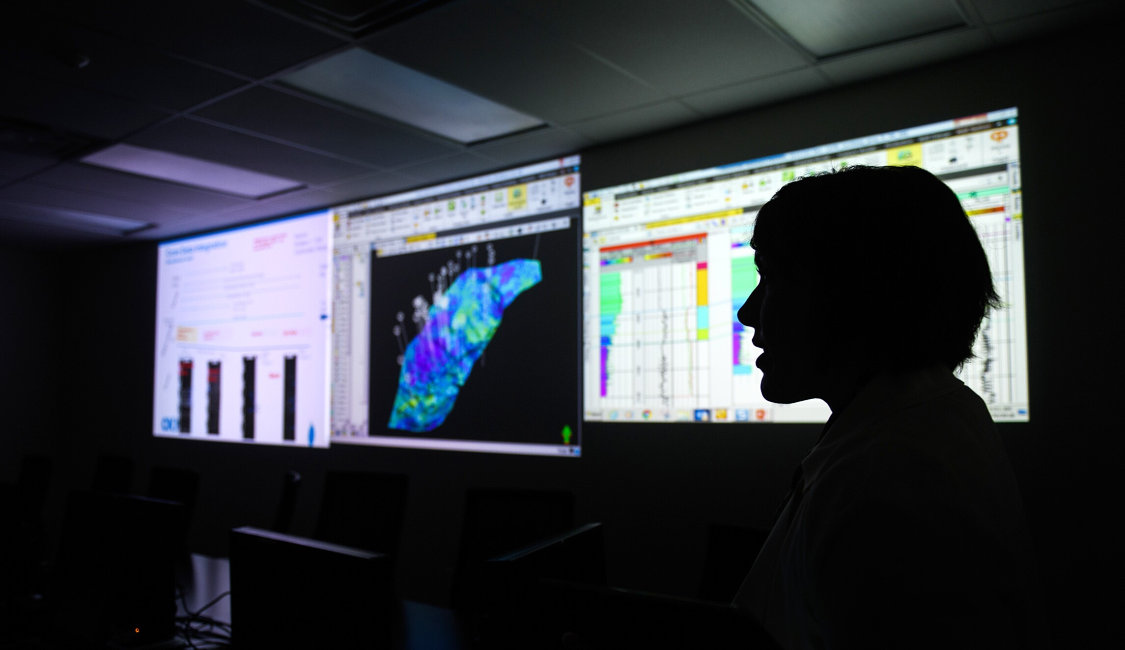 Vice President of Engineering and Development of CNX Resources Corporation Andrea Passman stands in a control room that is used for predicting drilling locations at CNX's headquarters on July 30 in Cannonsburg, Pa.