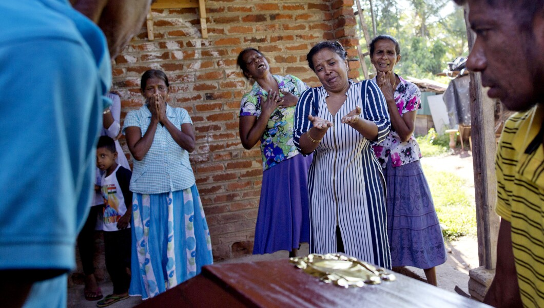 Relatives weep near the coffin with the remains of 12-year-old Sneha Savindi, who was a victim of Easter Sunday bombing at St. Sebastian Church, Monday, April 22, 2019 in Negombo, Sri Lanka.