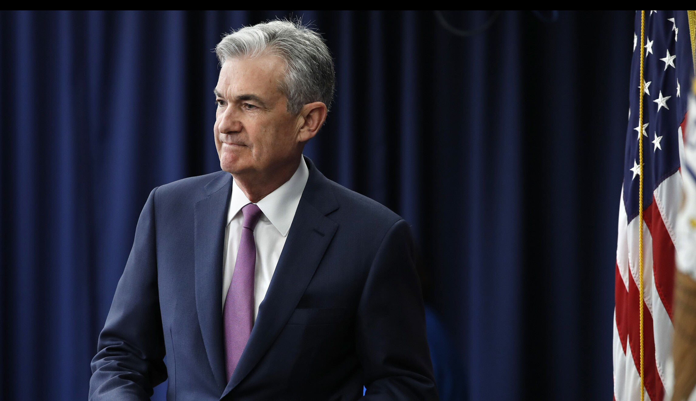 Fed leaves interest rates alone, resisting Trump's pressure for a cut
