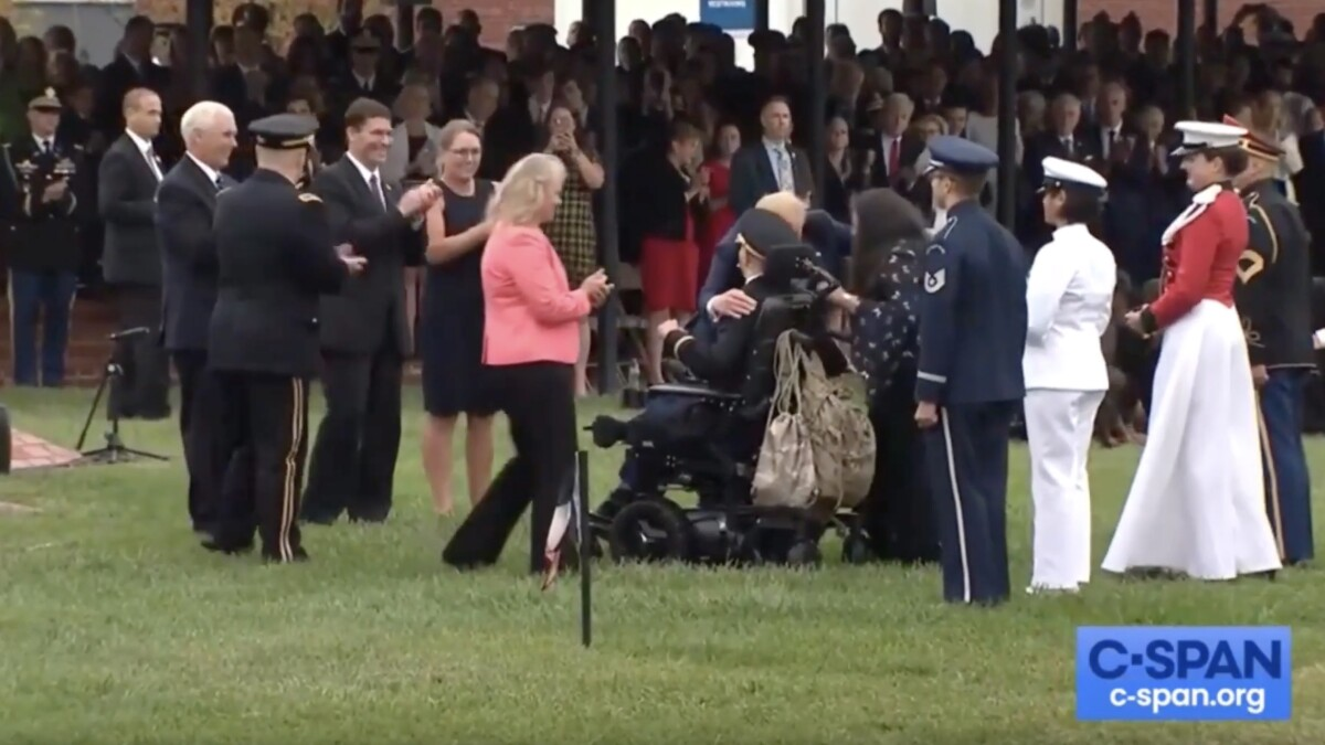 WATCH: Trump embraces wounded veteran who sang 'God Bless America' at military ceremony