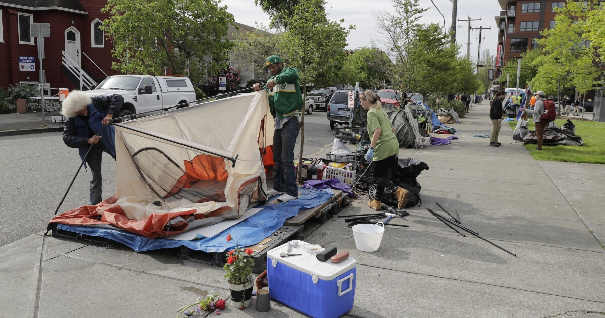 Parents furious over homeless camp on school property — but board says it's teachable moment