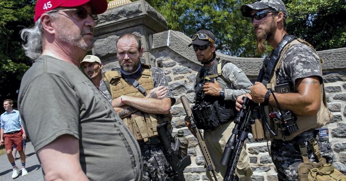 Division over armed militiamen patrolling protest-ridden cities