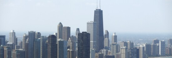 Sailboats practice in front of the downtown Chicago skyline.