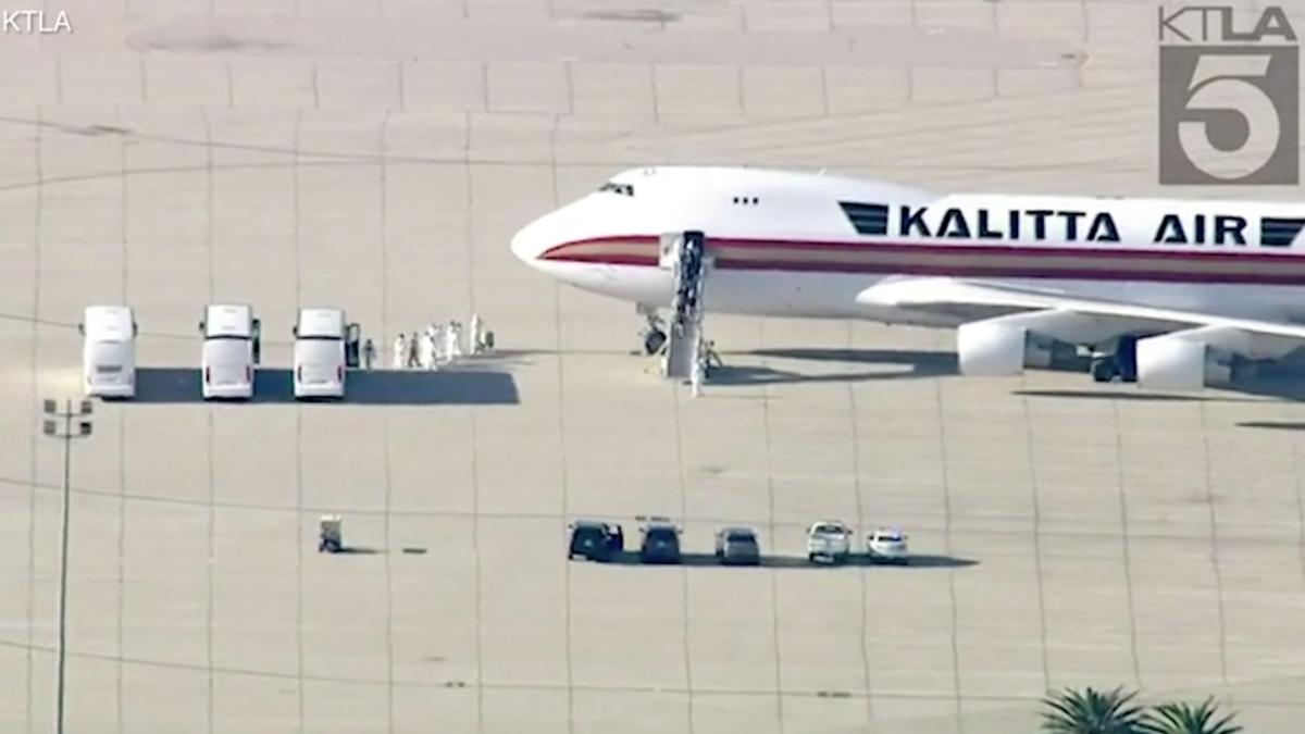 WATCH: American evacuees from Wuhan met by officials in hazmat suits in California