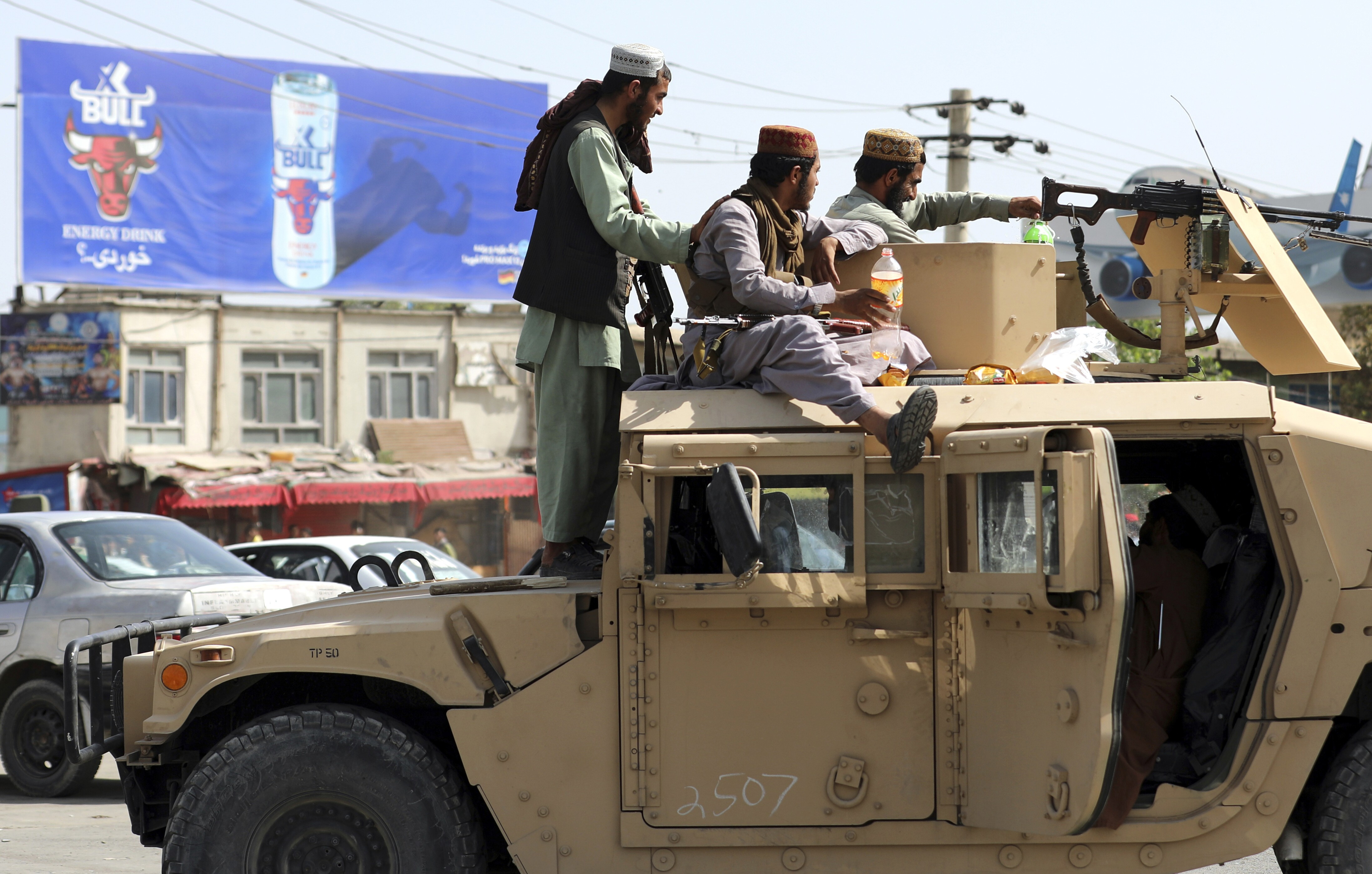 Taliban fighters stand guard in front of Hamid Karzai International Airport in Kabul, Afghanistan, on Aug. 16.