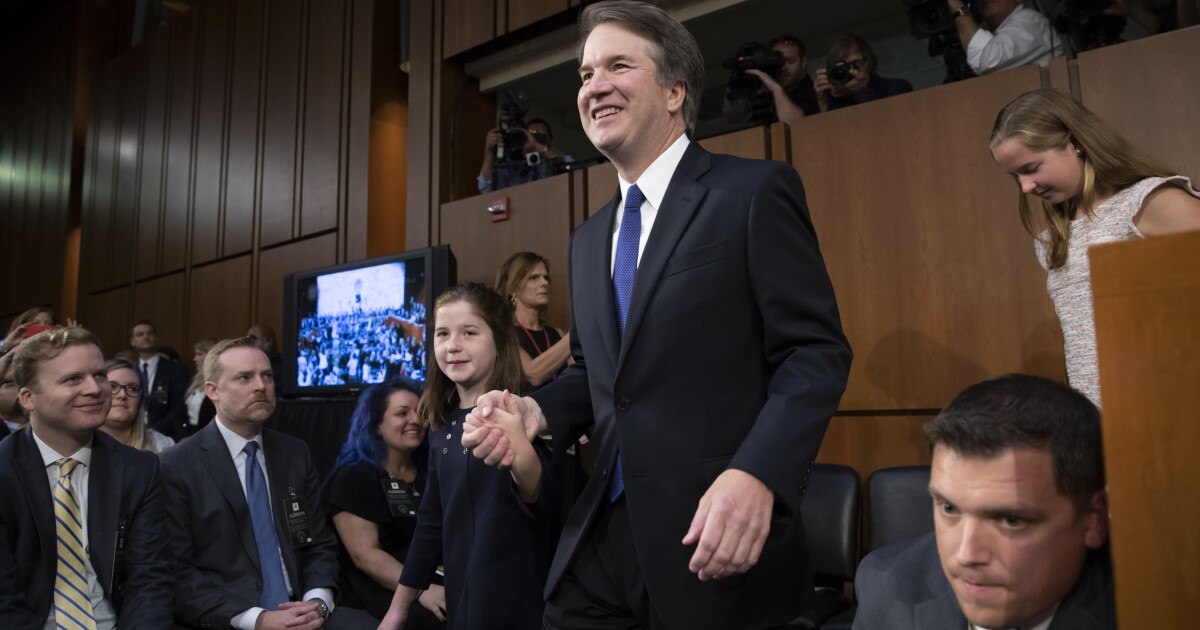 Brett Kavanaugh's daughters rushed out of chaotic, 'hot' hearing