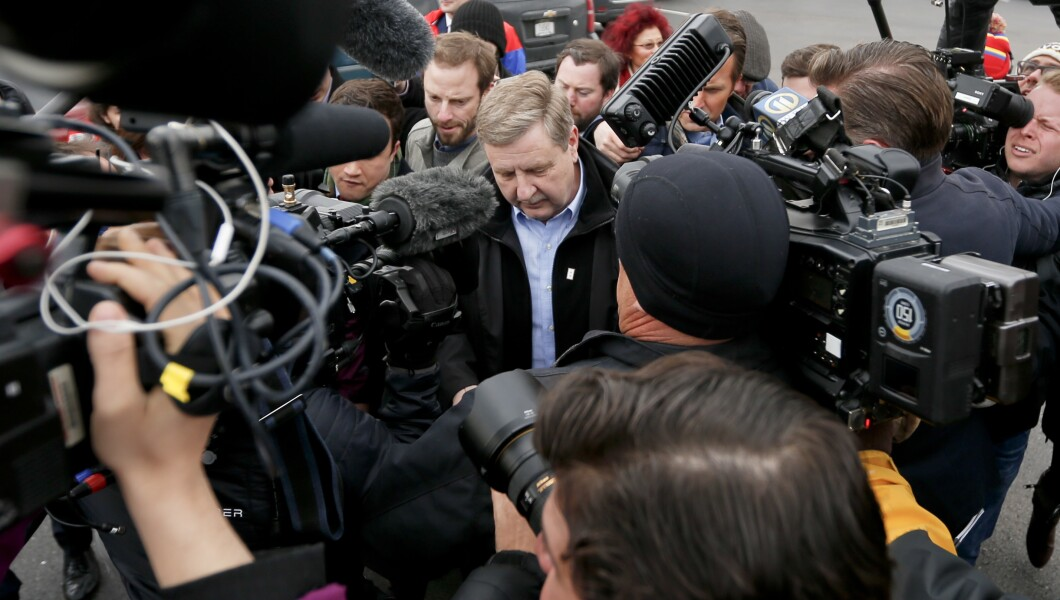 Republican Rick Saccone walks his way through a group of cameras and reporters as he casts his ballot on Tuesday.