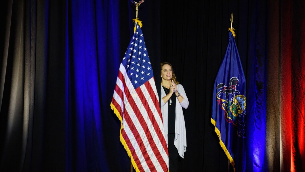 Abby Nassif Murphy, the campaign manager of Democratic candidate Conor Lamb, stands on a stage.