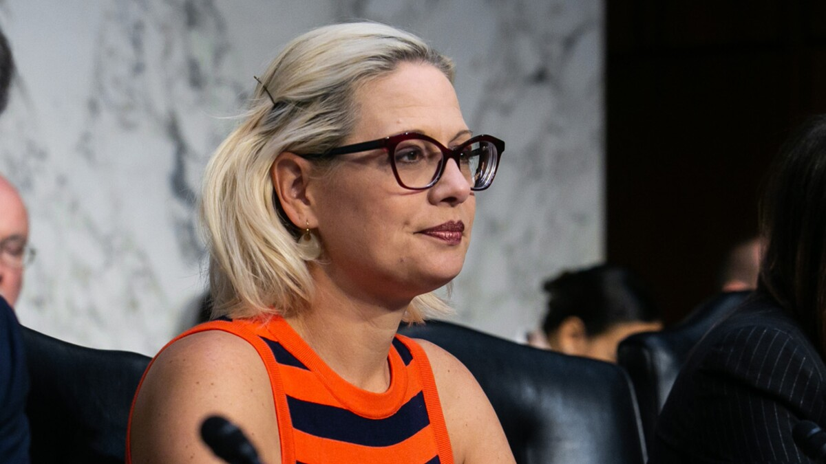 The mob comes for Kyrsten Sinema