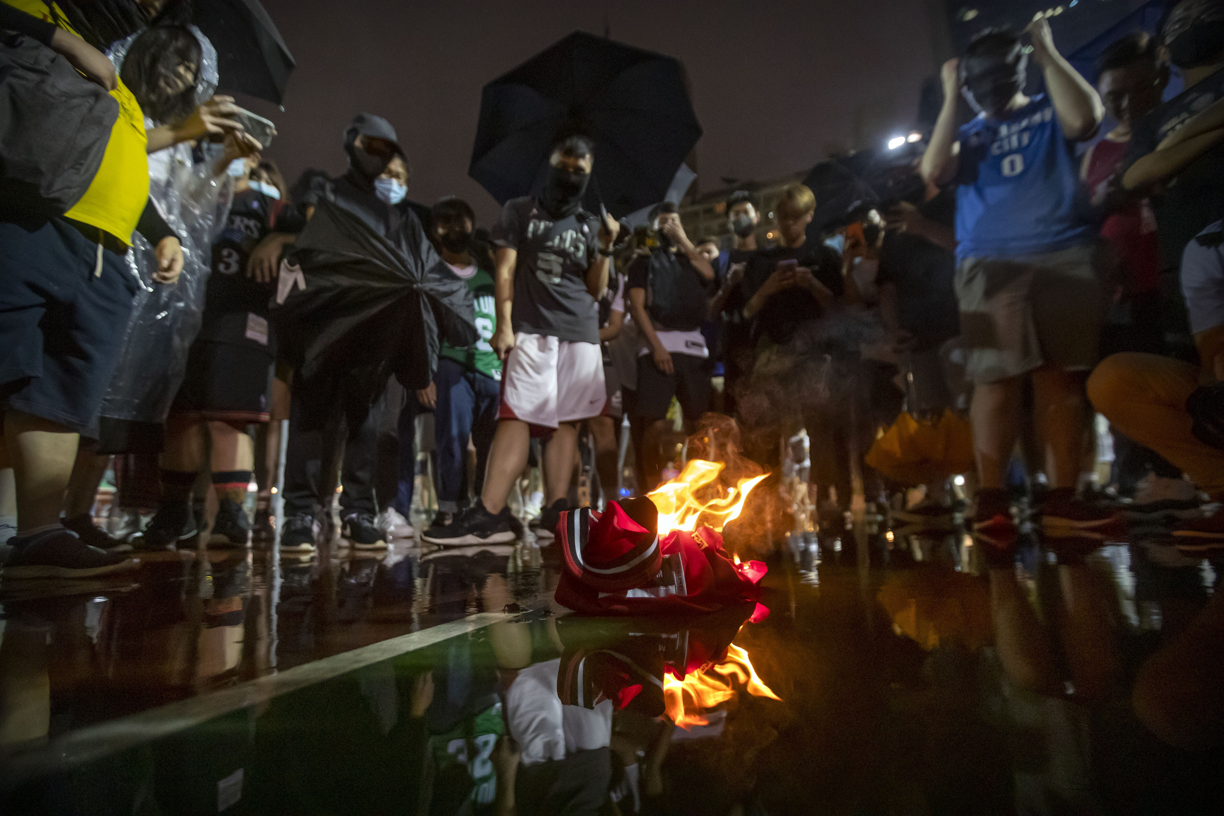 'Hong Kong lives also matter': Freedom protesters trample and burn LeBron James jerseys