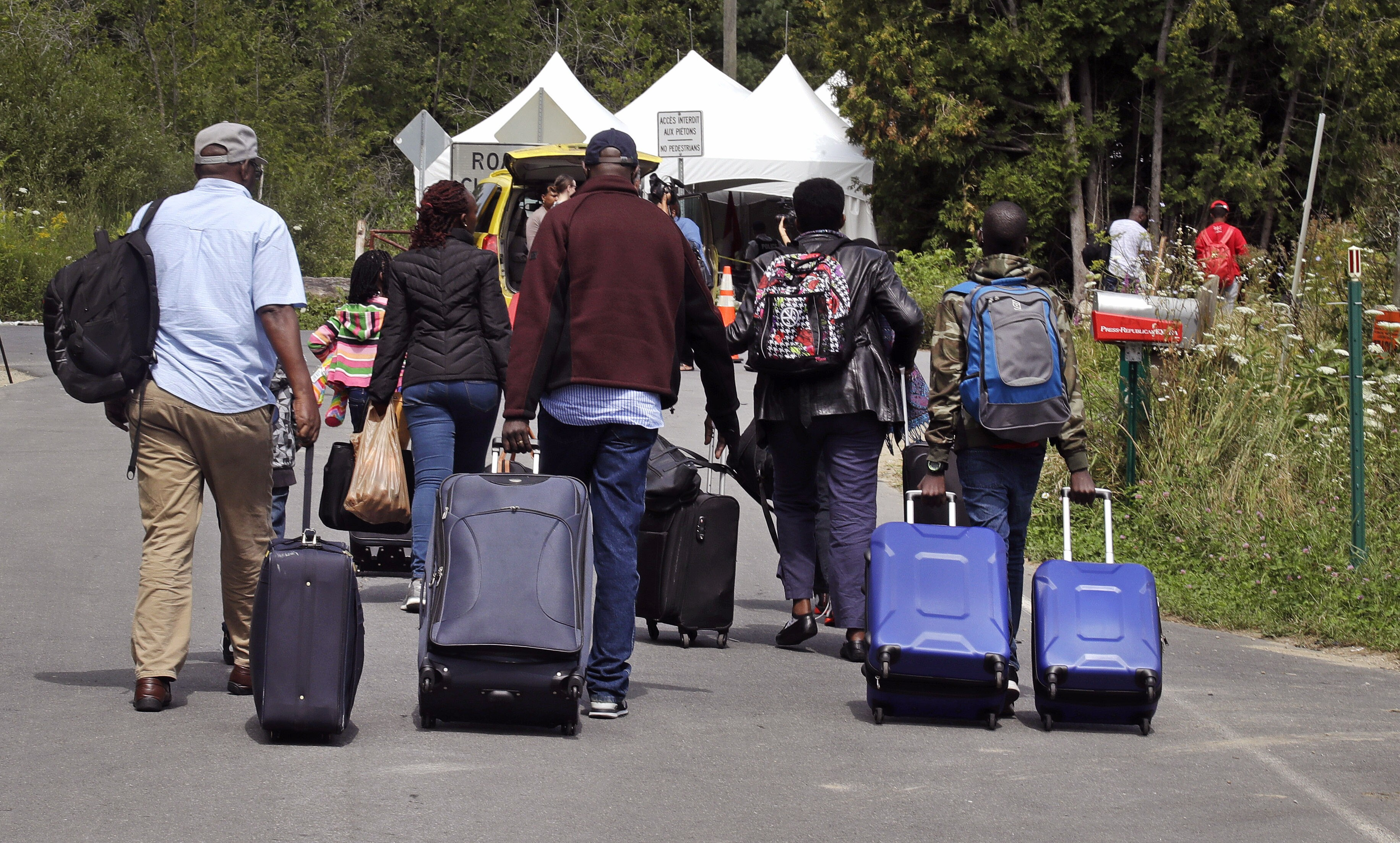 Tough Trump asylum policy prompts migrants to enter US and then flee to Canada