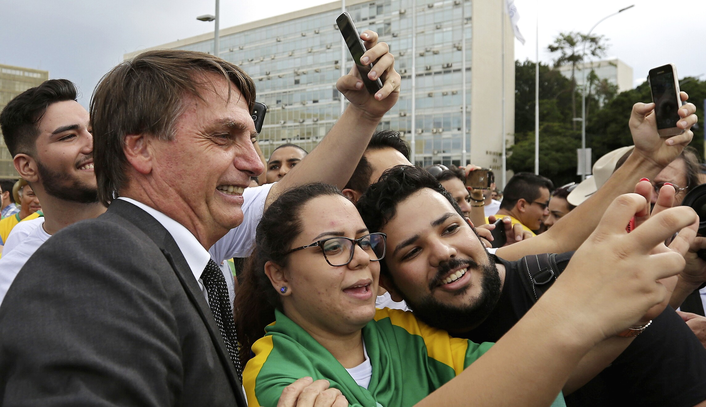 Demonstrators opposed to Brazil's former President Luiz Inacio Lula da Silva have their picture taken with lawmaker Jair Bolsonaro, the main right-wing candidate for the October presidential election, during a protest in Brasilia, Brazil.