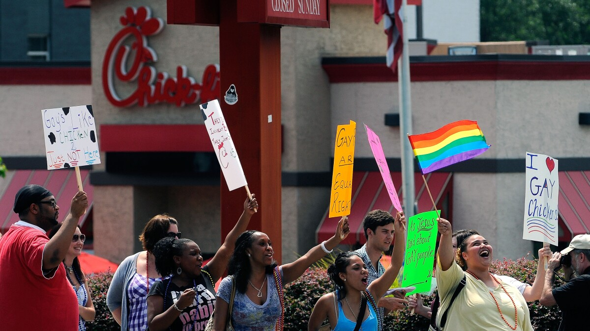Die-ins and chalk drawings: LGBTQ and animal rights activists protest new Chick-fil-A location