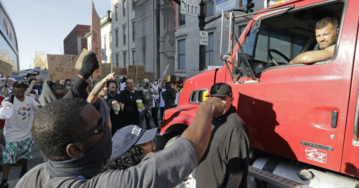 Amid protests, truckers determined not to become the next Reginald Denny